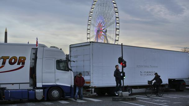 Fair workers block a central Paris interchange in protest at government orders to remove a giant Ferris wheel (AP)