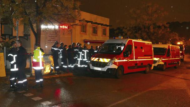 Firefighters and ambulances in the village of Montferrier-sur-Lez, as a manhunt for a gunman continued (AP)