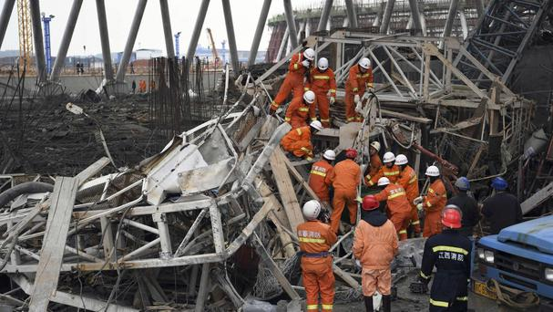Rescue workers look for survivors after China's latest construction site disaster (Xinhua News Agency/AP)