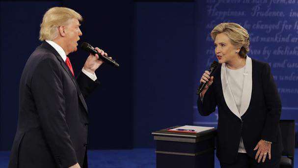 Donald Trump and Hillary Clinton trade blows at a TV debate (AP)