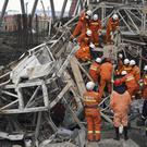 Rescue workers look for survivors after a scaffolding collapse in China (Xinhua News Agency/AP)