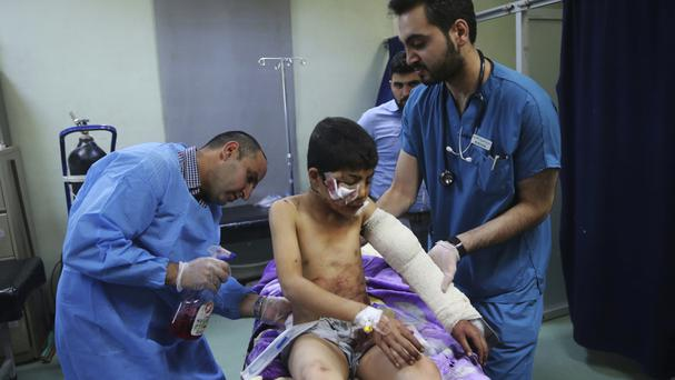An Iraqi boy who was injured in Mosul receives emergency hospital treatment (AP)