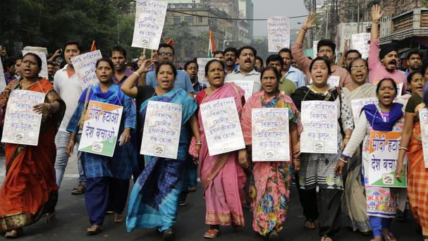 Activists of Trinamool Congress party hold banners during a protest march against the government's decision to withdraw high denomination notes (AP)