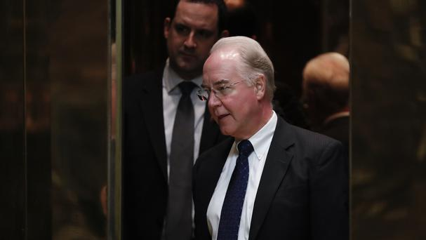 Closed-door session: The lift shuts on Tom Price as he arrives at Trump Tower in New York (AP)