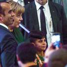 Afghan refugee Edris and his father meet with German Chancellor Angela Merkel (AP)