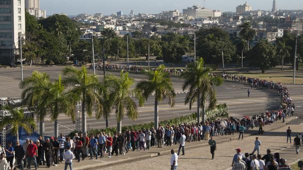 Mourners wait in line to visit the memorial site for Fidel Castro at the Revolution Plaza in Havana (AP)