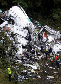 Rescue crew work in the wreckage from a plane that crashed into Colombian jungle with Brazilian soccer team Chapecoense near Medellin, Colombia.