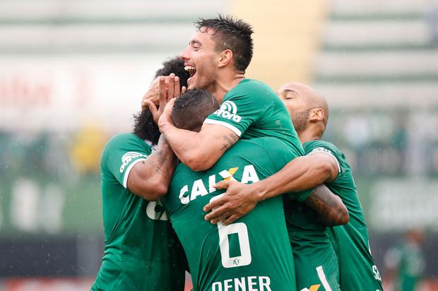 Chapecoense's Alan Ruschel, pictured celebrating with his teammates during a match this season, survived the plane crash. Photo: AP