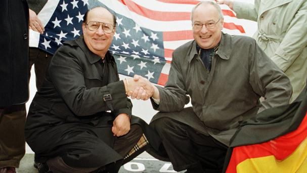 Joe Esposito, left, pictured in 1998 with Bremerhaven mayor Manfred Richter at the point Elvis Presley stepped on German soil during his army service (AP)