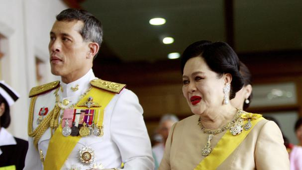 Thailand's Queen Sirikit, right, walks with her son Vajiralongkorn in Bangkok (AP)