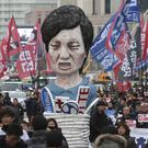 Union members call for President Park Geun-hye to step down in Seoul (AP)