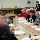 Ballots in Wisconsin are placed in front of workers as a state-wide presidential election recount begins (AP)