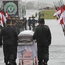 The coffins were taken to the stadium for a memorial service