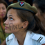 MOURNING: A cadet from the interior ministry with the word 'Fidel' painted on her face attends a rally honouring the late Cuban leader Castro at the Plaza de la Revolucion in Havana. Photo: Ramon Espinosa/AP