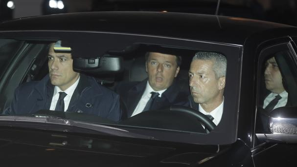 Italian premier Matteo Renzi arrives at the Quirinale Presidential Palace (AP)