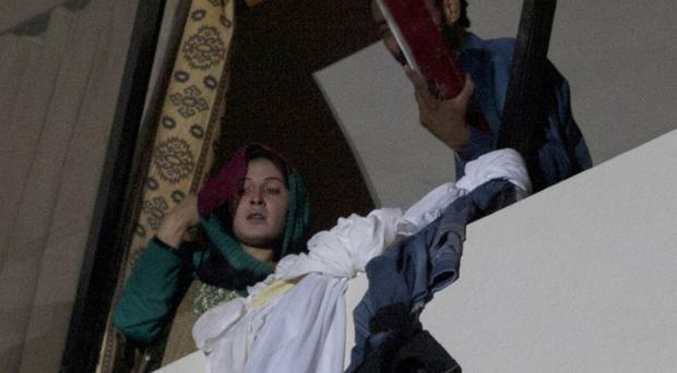 Guests climbed out of windows using knotted bedsheets (AP)
