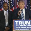Ben Carson listens to Donald Trump during a previous news conference in Palm Beach, Florida Credit: AP