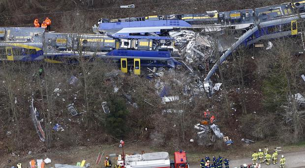 Rescue teams work at the site where two trains collided near Bad Aibling, Germany (AP)