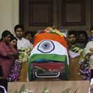 Politicians and friends surround the body of Jayaram Jayalalithaa kept for public viewing outside an auditorium in Chennai (AP)