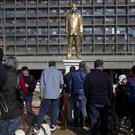 People look at a statue of Benjamin Netanyahu in Tel Aviv (AP)