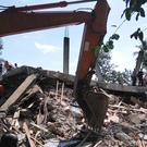 Rescuers use heavy machinery to search for survivors under the rubble (AP)