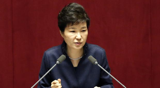 Prosecutors say Park Geun-hye let a corrupt confidante manipulate government affairs and extort businesses (AP)