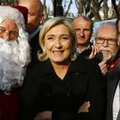 Far-right leader and presidential candidate Marine Le Pen at the Champs Elysees Christmas market in Paris (AP)