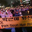 Protesters demand the impeachment of South Korean President Park Geun-hye (AP)