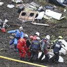 Rescue workers at the wreckage site near Medellin, Colombia (AP)