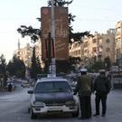 Police direct traffic in Aleppo, Syria (AP)