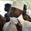 Yahya Jammeh shows his inked finger before voting in Banjul on December 1 (AP)