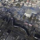 The scene of devastation after a tanker train derailed and a gas tank exploded in the village of Hitrino, Bulgaria (AP)