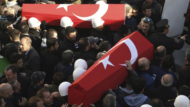 People carry the coffins of victims during a funeral in Istanbul (AP)