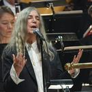 Patti Smith performs during the award ceremony at the Stockholm Concert Hall (TT News Agency/AP)