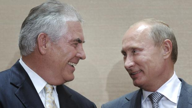 A smiling Vladimir Putin, right, with Rex Tillerson during a signing ceremony in the Black Sea resort of Sochi in 2011 (RIA Novosti/AP)