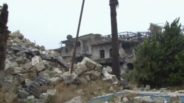 This frame grab from a video, shows damaged buildings near the ancient Umayyad Mosque, in the Old City of Aleppo, Syria.