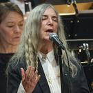 Patti Smith, pictured at the Nobel ceremony performing A Hard Rain's A-Gonna Fall, said she was overcome with emotion (TT News Agency/AP)