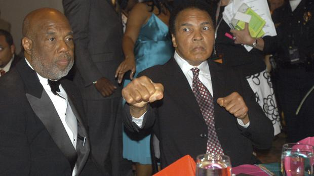 Photographer Howard Bingham, left, and Muhammad Ali at a reception at the Muhammad Ali Centre in Louisville, Kentucky, in 2006. (AP)