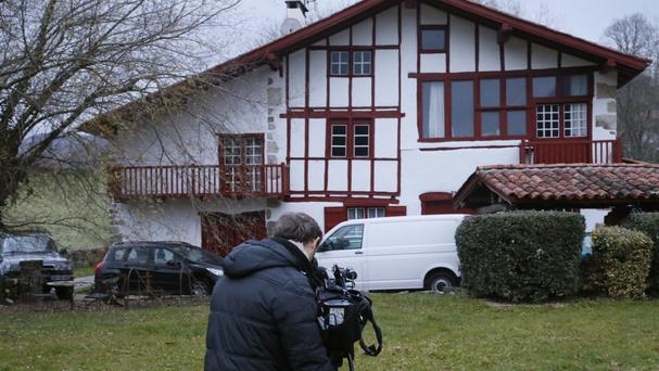 A cameraman films a house where arrests of Basque activists took place in Louhossoa, southern France (AP/Bob Edme)