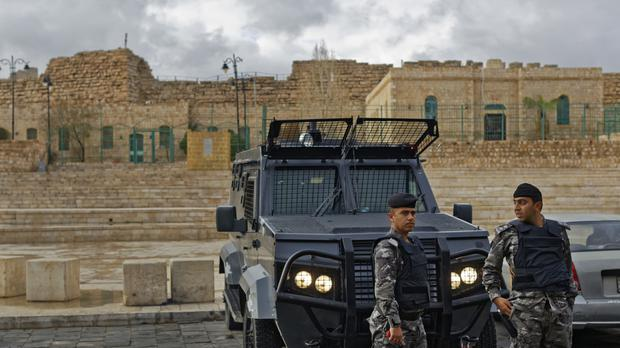 Jordanian security forces and their armoured vehicles stand guard in front of Karak Castle in the central town of Karak. (AP Photo/Ben Curtis)