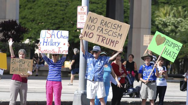 A rally outside the Hawaii State Capitol as people protested against President-elect Donald Trump (AP)
