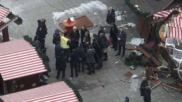 German Chancellor Angela Merkel visits the site of the attack in Berlin. (AP)