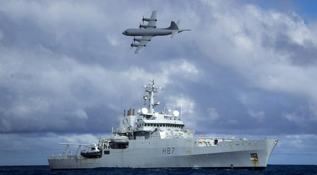 Survey ship HMS Echo, with a Lockheed P-3 Orion overhead, helping the search for Malaysia Airlines Flight MH370 in the southern Indian Ocean (MoD/PA)