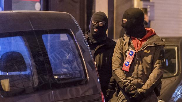 Police search an area in the Schaerbeek area in Brussels (AP)