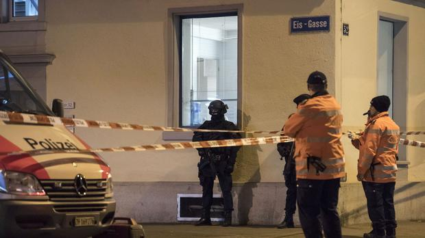 Police secure the area in front of the Islamic Centre in Zurich following the shooting (AP)
