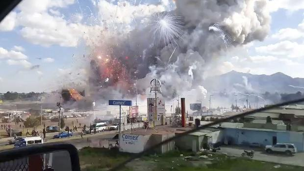 This image made from video recorded from a passing car shows an explosion ripping through the San Pablito fireworks market in Tultepec (Jose Luis Tolentino/AP)