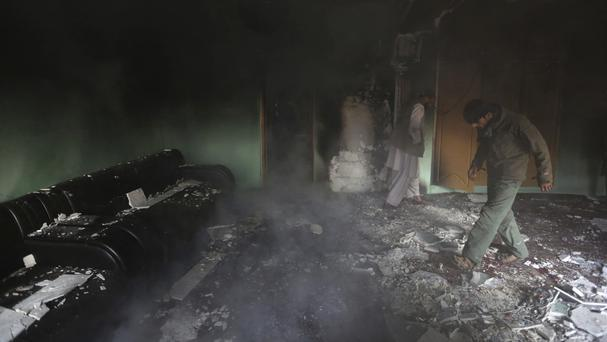 The aftermath of a Taliban attack on a politician's home in Kabul that left 11 people dead, including three gunmen (AP)