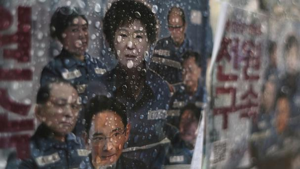 A poster showing a portrait of impeached South Korea President Park Geun-hye (AP)