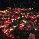 Candles are lit at Breitscheidplatz, in Berlin in tribute to the 12 people who died after a lorry ploughed into a crowded Christmas market