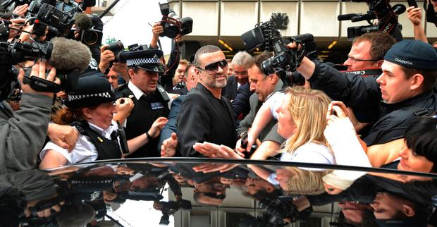 George Michael outside Highbury Corner Magistrates'Court in London in 2010, where he was jailed for eight weeks for crashing his car into a shop while under the influence of cannabis Picture: AFP